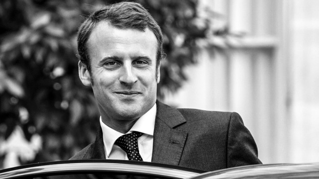 French Economy minister Emmanuel Macron leaves after a meeting with regions prefects and regional administration managers at the Elysee palace in Paris September 1, 2014. REUTERS/Alain Jocard/Pool (FRANCE - Tags: POLITICS) - RTR44ICI